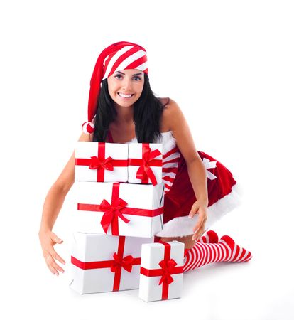 beautiful young brunette woman dressed as Santa sitting on the floor with a lot of presents  photo