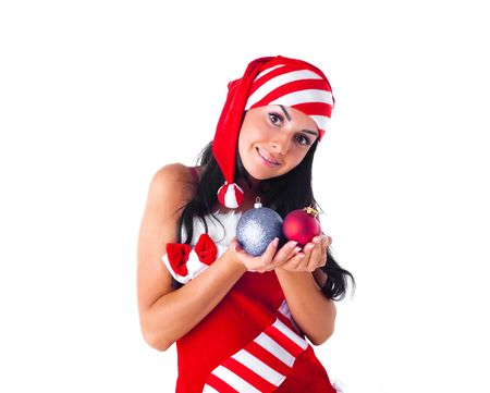happy beautiful girl dressed as Santa holding decorations for the fir tree Stock Photo - 7890397