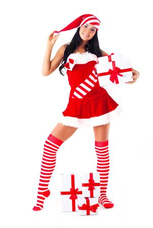 beautiful young brunette woman dressed as Santa with presents in her hands Stock Photo - 7890383