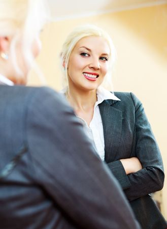 young confident businesswoman looking at herself in the mirror photo