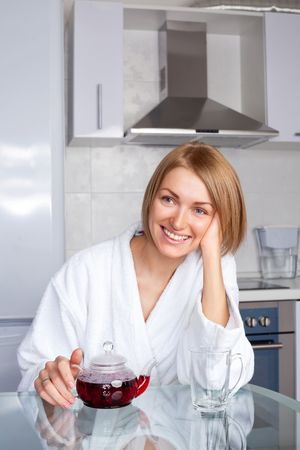 beautiful happy young woman drinking tea at home in the morning Stock Photo - 8191354