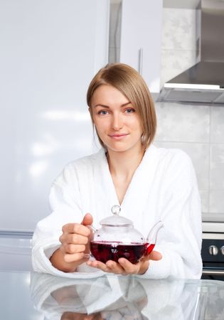 beautiful happy young woman drinking tea at home in the morning photo