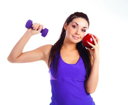 beautiful brunette girl with a dumbbell and an apple Stock Photo - 8191363