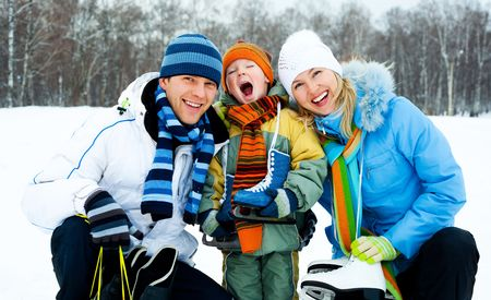 happy young parents going ice skating with their son Stock Photo - 8191417