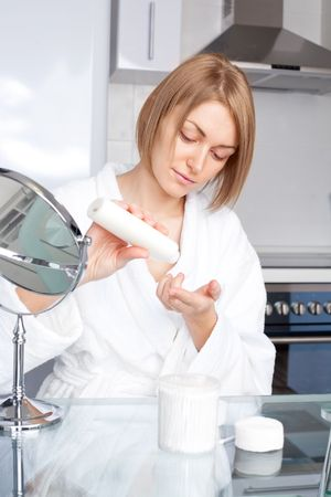 beautiful young woman using cosmetics at home Stock Photo - 8191791