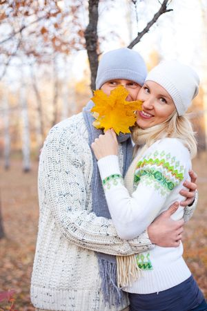 happy young couple spending time outdoor in the park  photo