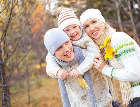 outsides: happy young family spending time outdoor in the park (focus on the father) Stock Photo