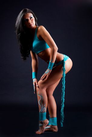 body paint sexy: beautiful brunette dancer with bodyart, against black background Stock Photo