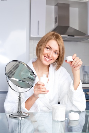 beautiful young woman using cosmetics at home Stock Photo - 8331959