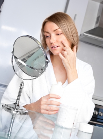 young upset woman has problems with her skin photo