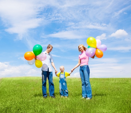 happy family with balloons outdoor on a summer day Stock Photo - 8332046