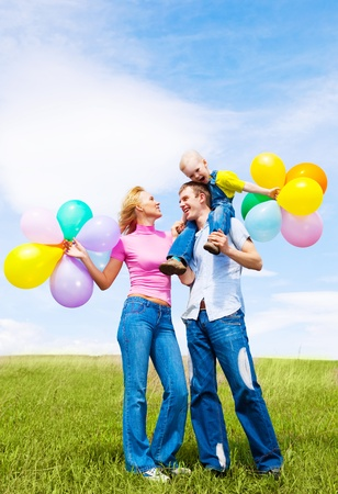 happy family with balloons outdoor on a summer day Stock Photo - 8331996
