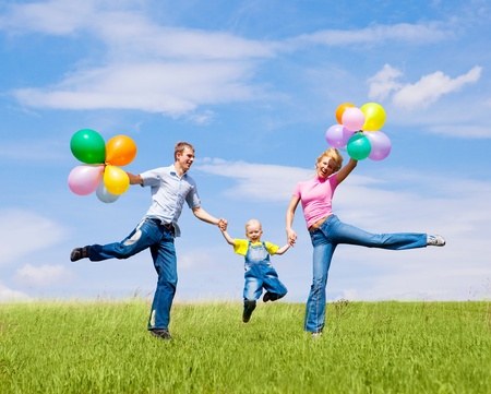 happy family with balloons outdoor on a summer day Stock Photo - 8331990