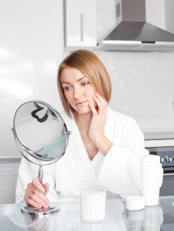 young upset woman has problems with her skin Stock Photo - 8402371