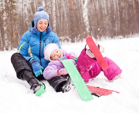 happy family; young mother and her daughter skiing and having fun in the winter park (focus on the child) Stock Photo - 8563106