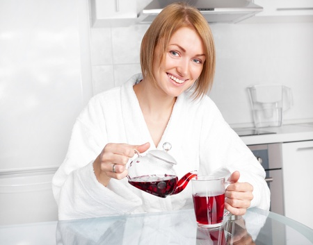 beautiful happy young woman drinking tea at home in the morning Stock Photo - 8563139
