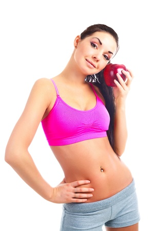 beautiful young sporty woman holding a big red apple photo