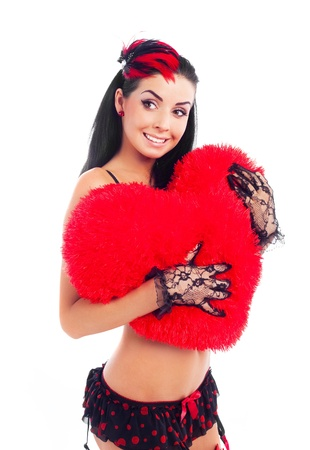 sexy young brunette woman wearing beautiful underwear with a heart shaped pillow in her hands photo