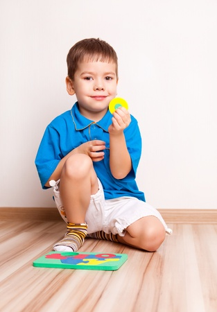 four year old: cute four year old boy plaing with toys on the floor at home Stock Photo