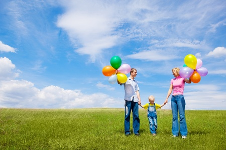 happy family with balloons outdoor on a summer day Stock Photo - 8732669
