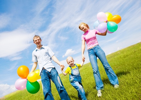happy family with balloons outdoor on a summer day Stock Photo - 8732670