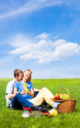 tender tenderness: happy young couple having a picnic outdoor on a summer day