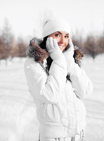 pretty young brunette woman wearing warm winter clothes outdoor photo