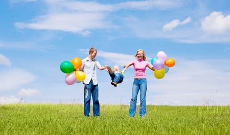 happy family with balloons outdoor on a summer day Stock Photo - 8732702