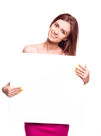 Beautiful young sexy woman holding empty white board Stock Photo - 8860486
