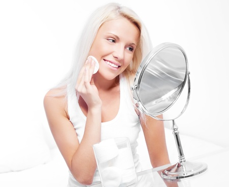 beautiful young blond woman using cotton pads at home Stock Photo - 8941835