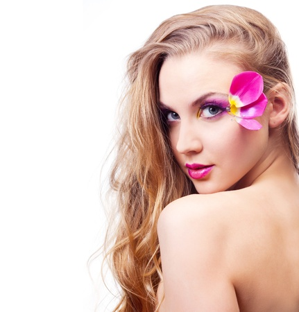 appealing: beautiful young woman with creative makeup with tulip petals
