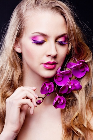 long silky hair: beautiful young woman with luxurious long curly hair and an orchid