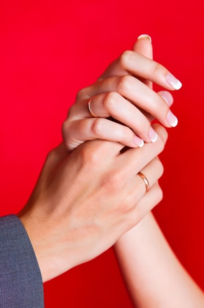 hands of a bride and a groom with golden wedding rings  photo