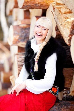 beautiful young blond Russian woman with a long plait photo