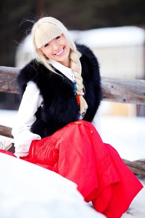 beautiful young blond Russian woman with a long plait Stock Photo - 9078112