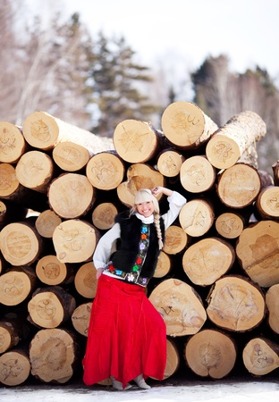 beautiful young blond Russian woman with lumber outdoors photo