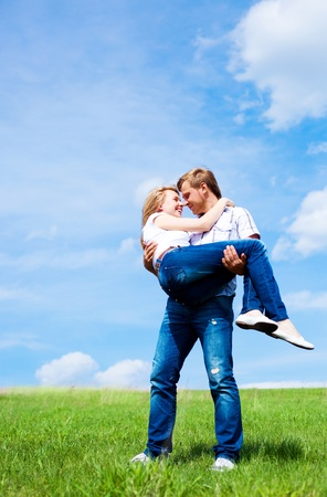 happy young loving couple having fun outdoor in summertime photo