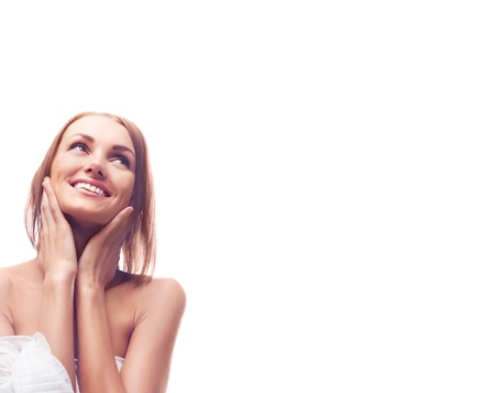beautiful happy young woman touching her neck and looking up, a lot of copy space to the right Stock Photo - 9155276