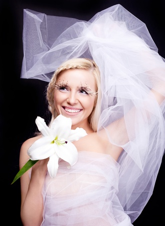 beautiful young blond woman with a lily and creative makeup photo