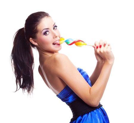 sexy tongue: pretty smiling brunette girl with a lollipop in her hand Stock Photo
