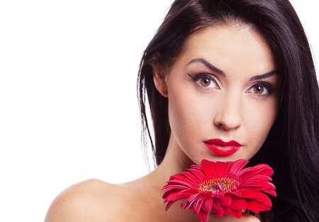 sexy young brunette woman with a red flower, isolated against white background Stock Photo - 9195104