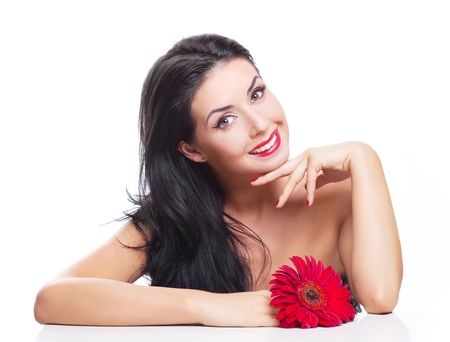 seductive women: sexy young brunette woman with a red flower, isolated against white background