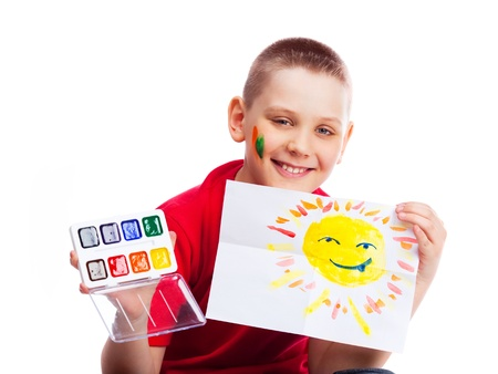 cute ten year old boy with a watercolor picture of the sun Stock Photo - 9294881
