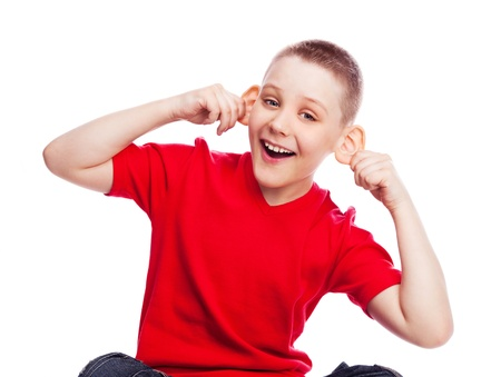 happy ten year old boy laughing and making faces, isolated against white photo