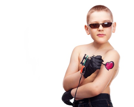 ten year old: ten year old boy making himself a tattoo of a heart on the arm