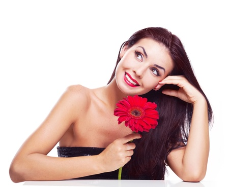 sexy young brunette woman with a red flower, isolated against white background Stock Photo - 9312089