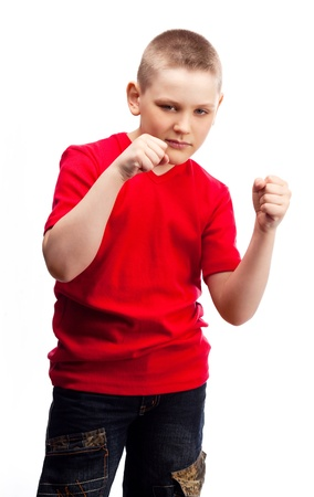 aggressive ten year old boy showing his fists photo