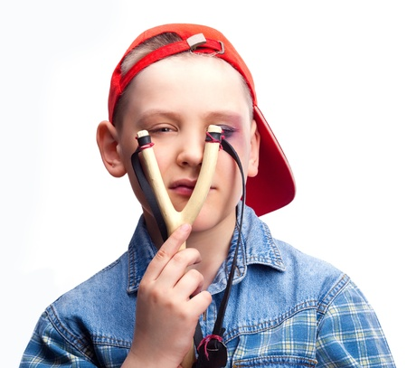 naughty boy with a bruise under his eye holding a slingshot Stock Photo - 9312095