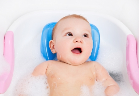 cute six months old baby taking a relaxing bath with foam Stock Photo - 9312111