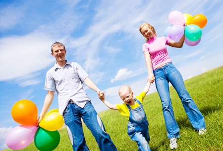 happy family with balloons outdoor on a summer day Stock Photo - 9378032